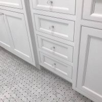 custom bathroom tile floor and cabinet hardware