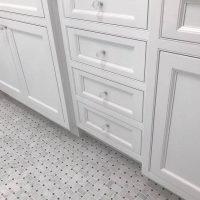 custom bathroom tile floor and cabinet hardware