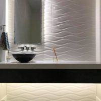 floating vanity and tile accent wall
